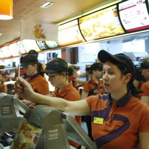Service staff attend to customers at a McDonald's restaurant in Moscow February 1, 2010. The first McDonald's in Russia, located in Moscow's Pushkin Square, celebrates its 20th anniversary today.   REUTERS/Denis Sinyakov  (RUSSIA - Tags: BUSINESS FOOD)