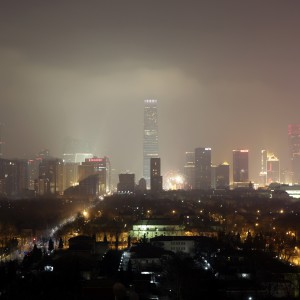 Buildings are pictured amid the heavy haze at night in Beijing's central business district, January 30, 2014. China could grant its undersized environment ministry new powers over resources, reported on February 10, possibly allowing it to veto future projects, and more muscle to punish polluters as part of a government shake-up to tackle decades of unchecked growth. Picture taken January 30, 2014. REUTERS/Jason Lee (CHINA - Tags: ENVIRONMENT BUSINESS) - RTX18IM6