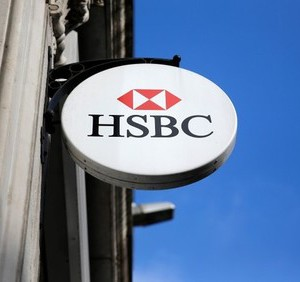 An HSBC sign is seen outside a bank branch in London February 9, 2015. REUTERS/Suzanne Plunkett
