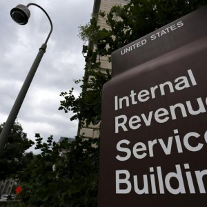 A security camera hangs near a corner of the U.S. Internal Revenue Service (IRS) building in Washington May 27, 2015. Tax return information for about 100,000 U.S. taxpayers was illegally accessed by cyber criminals over the past four months, U.S. IRS Commissioner John Koskinen said on Tuesday, the latest in a series of data thefts that have alarmed American consumers. REUTERS/Jonathan Ernst