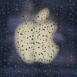 Raindrops are seen in front of an Apple logo outside an Apple store in Shanghai February 22, 2012. A Shanghai court began hearing on Wednesday a case brought by a Chinese technology firm seeking to halt the sale of Apple Inc's iPads across the affluent Chinese city, accusing the U.S. firm of trademark infringement. REUTERS/Aly Song