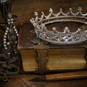 low key image of beautiful diamond queen crown on old book. vintage filtered and toned. fantasy middle age concept