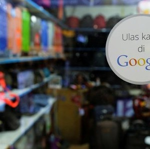 A sticker reading 'Review us on Google' is pictured at a smartphone shop in Ambassador Mall in Jakarta, Indonesia, September 19, 2016. REUTERS/Beawiharta