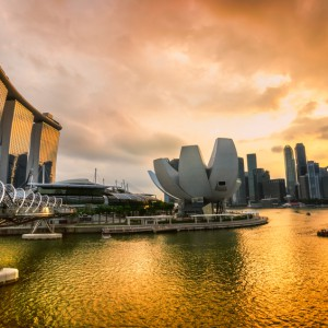 Wide-angle view of Singapore city skyline at sunset...