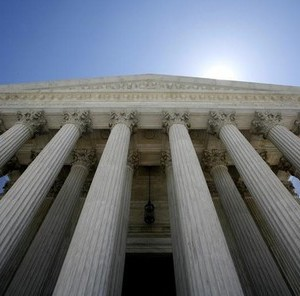 The U.S. Supreme Court building seen in Washington May 20, 2009. .   REUTERS/Molly Riley