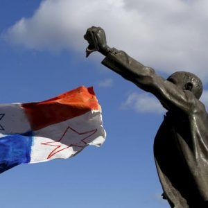 A Panamanian flag flies in the wind near a statue of Maltese pre-independence social reformer Manwel Dimech during a demonstration calling on Maltese Prime Minister Joseph Muscat to resign after two members of his government were named in the Panama Papers leak scandal, outside the office of the Prime Minister in Valletta, Malta, April 10, 2016. REUTERS/Darrin Zammit Lupi    MALTA OUT. NO COMMERCIAL OR EDITORIAL SALES IN MALTA