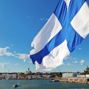 Flag of Finland against Helsinki panorama
