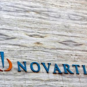 A Novartis logo is pictured on its headquarters building in Mumbai April 1, 2013.  REUTERS/Vivek Prakash/File Photo - RTX2SQP4