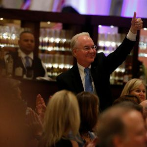 U.S. President-elect Donald Trump's nominee to be Secretary of Health and Human Services (HHS), Representative Tom Price (R-GA), gives a thumbs-up as Trump mentions him in his remarks at a luncheon with his cabinet members and congressional leaders at Trump International Hotel in Washington, U.S. January 19, 2017. REUTERS/Jonathan Ernst
