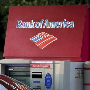 A Bank of America customer uses an ATM machine at a branch in Greenville, South Carolina January 18, 2012. REUTERS/Chris Keane