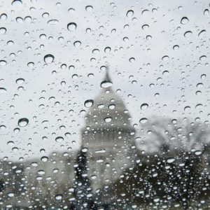 The U.S. Capitol building is seen in the rain as the U.S. House of Representatives prepare for a planned vote on the American Health Care Act, promoted by House Republicans and the Trump administration to repeal and replace the Affordable Care Act act known as Obamacare, on Capitol Hill in Washington, U.S., March 24, 2017. REUTERS/Jim Bourg