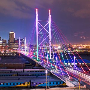 Multicolored lighting on Nelson Mandela Bridge in Johannesburg city.