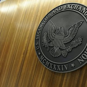 FILE PHOTO - The seal of the U.S. Securities and Exchange Commission hangs on the wall at SEC headquarters in Washington, DC, U.S. on June 24, 2011.    REUTERS/Jonathan Ernst/File Photo
