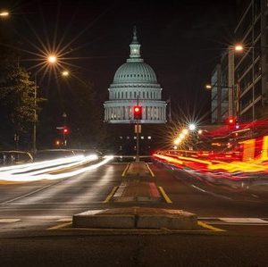 A red traffic light stands in front of the U.S. Capitol building in Washington September 30, 2013.  REUTERS/James Lawler Duggan