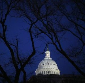 The U.S. Capitol building is seen before the start of President Barack Obama's primetime address to a joint session of the U.S. Senate and House of Representatives on Capitol Hill in Washington February 24, 2009.   REUTERS/Jim Young   (UNITED STATES) - RTXC1P9